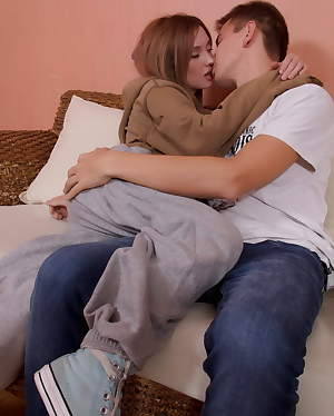 Hot teen couple having sex on the sofa