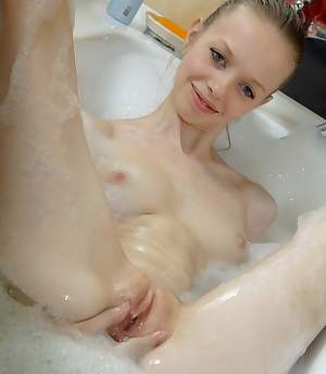Beauty-Angels.com - Skinny cutie masturbates in a bathroom